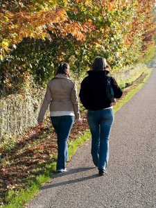 two young women walking along a country road
