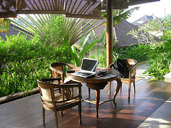 Indonesian veranda with table, chairs and laptop