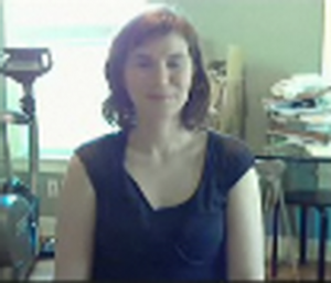 video conference view of woman in messy home office