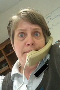 Startled woman on telephone