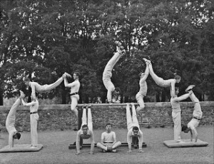 old photo (1920's of men doing gymnastic poses.