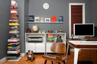 home office improvements with grey wall and white IKEA furniture and Eames chair