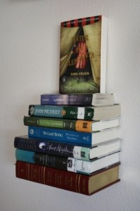 umbra's invisible book shelf Books in a stack appear attached to the wall