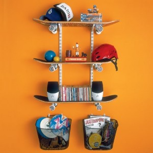 Skateboard shelving  three skate boards mounted to wall as shelves