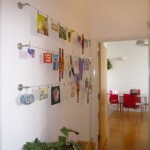 Ikea dignitet curtain hanging system used to display artwork