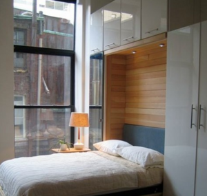 a murphy bed, wall bed makes a home office into a guest room